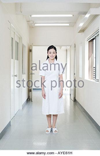 Nurse in a hospital corridor - Stock Image