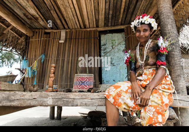Local woman her house Kuiawa, Papua New Guinea - Stock-Bilder