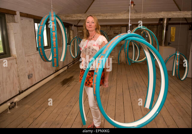 Artist Ros Burgin with her 12-piece installation 'Skylines' intended to celebrate (and inspire) female airline - Stock Image