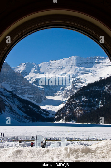 Victoria glacier seen through the oval restaurant window at Fairmont chateau lake louise - Stock Image
