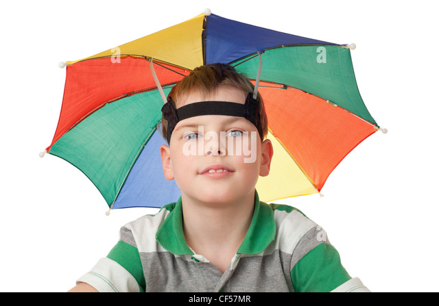 boy with multi-coloured umbrella on head isolated on white background - Stock Image