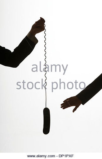 Two arms passing a telephone - Stock Image