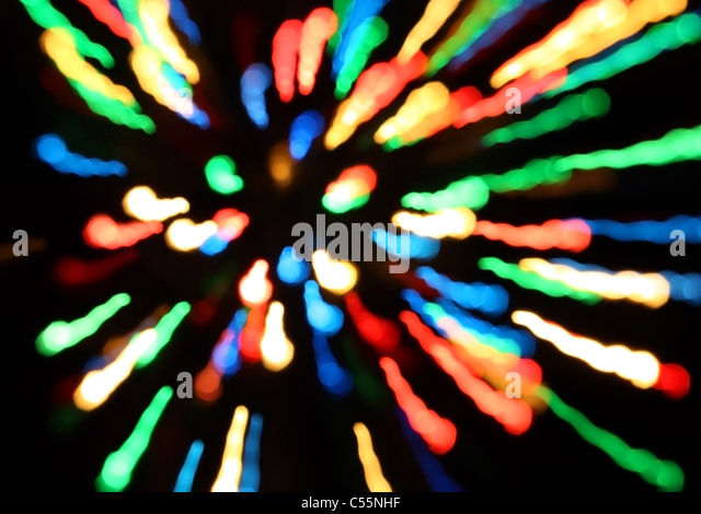 Bands of different colors red blue green yellow orange on a black background - Stock Image