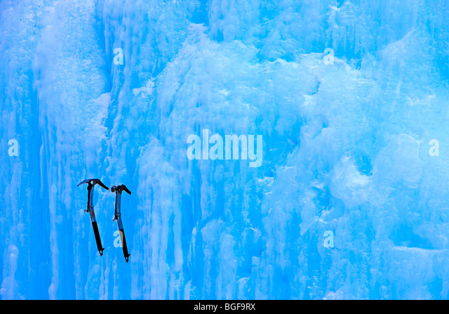 Two ice picks lodged on a frozen wall of ice at the Upper Falls during winter, Johnston Canyon, Banff National Park, - Stock Image