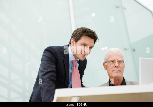 Two men looking at a display - Stock-Bilder