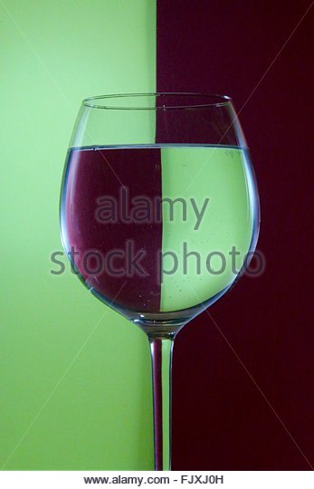 Close-Up Of Drink With Reflection Against Wall - Stock Image