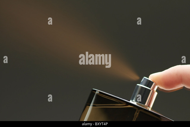 spray from aftershave / perfume bottle - Stock Image