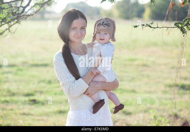 portrait of baby and mother - Stock Image