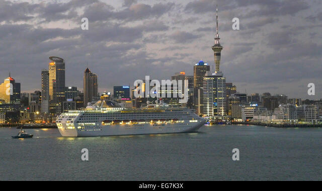 Cruise liner Sun Princess docking in Auckland at dawn, Wednesday February 11, 2015 - Stock Image