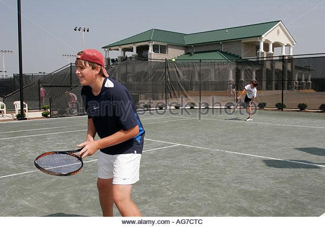 Huntsville Alabama Tennis Center teens sports play court - Stock Image