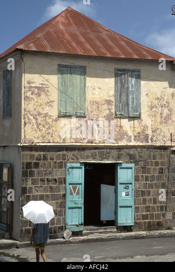 West Indies Nevis Charlestown Prince William Street resident weatherworn building - Stock Image