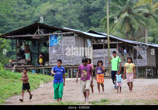 indigenous tribes people and wooden houses on stilts in the jungle village Puerto Alegre Nauca,  Choco province, - Stock Image