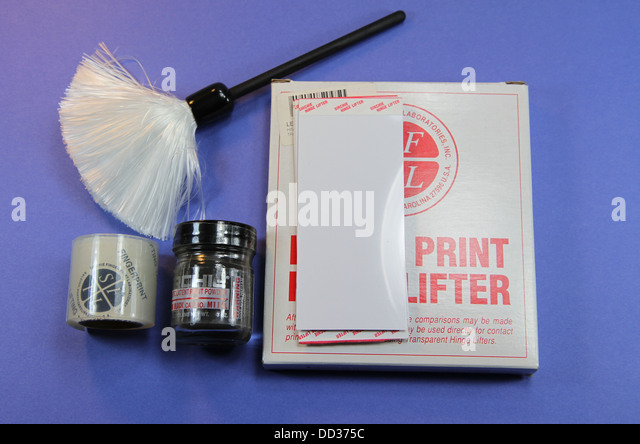 Forensics fingerprint evidence kit. Brush, powder, and both tape and hinge lifters for transferring the prints into - Stock Image