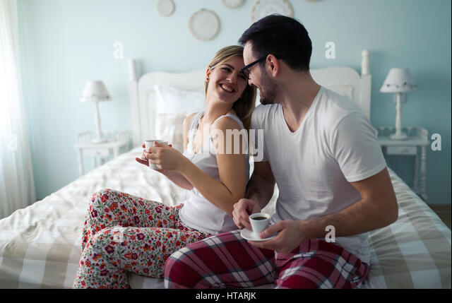 Couple enjoying their romantic morning and coffee - Stock Image