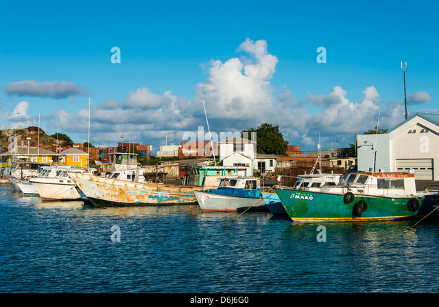 Boats in the harbour of the capital St. Johns in Antigua, Antigua and Barbuda, West Indies, Caribbean, Central America - Stock Image