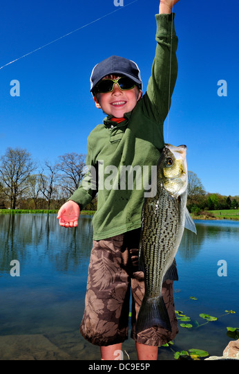 Young boy fishing in a Pennsylvania pond - Stock Image