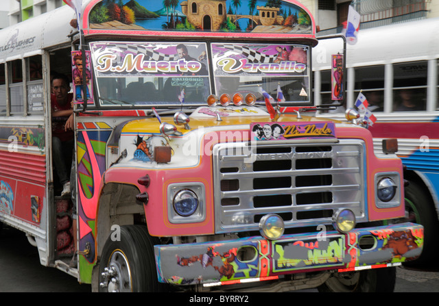Panama City Panama Calidonia neighborhood Diablo Rojo bus public transportation custom paint job colorful design - Stock Image