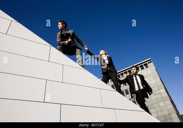 3 people on roof - Stock Image