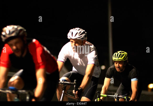 Cyclists cycling on track at velodrome - Stock Image