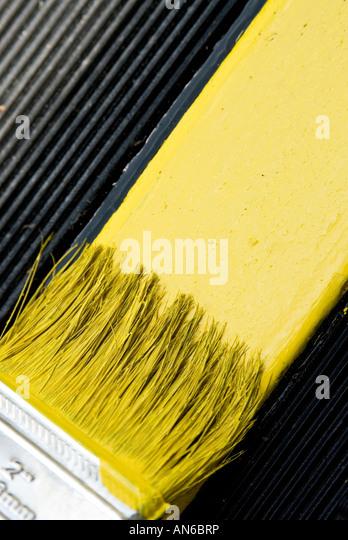 Brush painting yellow, close-up - Stock-Bilder