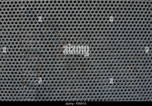 Corroded Metal grill with circular holes - Stock Image