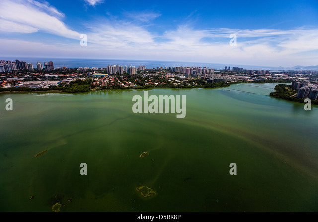 Lagoa de Jacarepagua Barra da Tijuca unfit for swimming, fishing and water sports due to pollution. Luxury condominiums - Stock Image