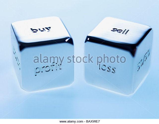 Close up silver cubes with sayings on them - Stock Image
