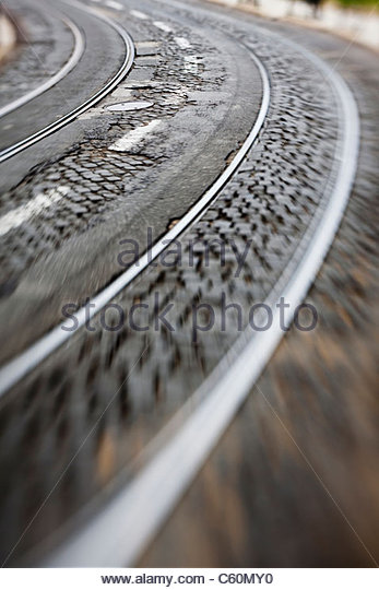 Blurred view of urban train tracks - Stock Image
