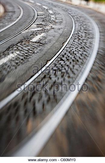Blurred view of urban train tracks - Stock Image