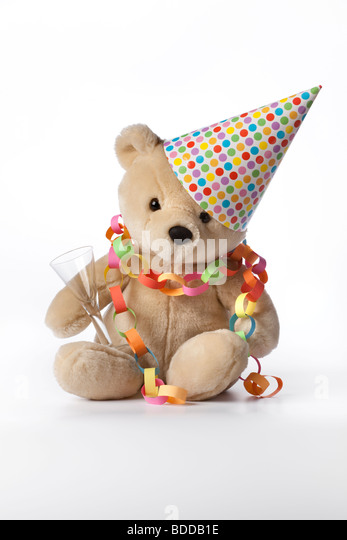 Party bear with hat, glass and decoration - Stock Image