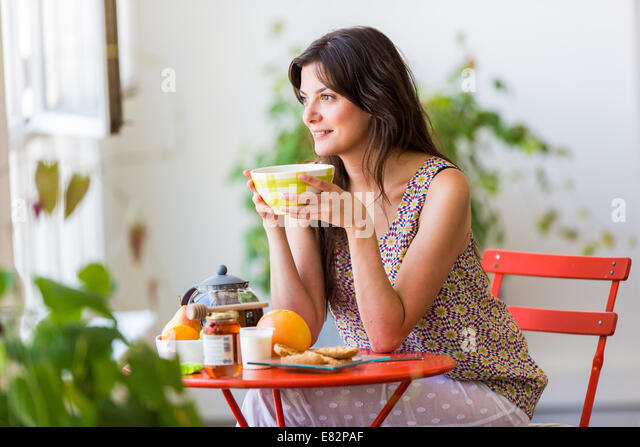 Woman having breakfast. - Stock-Bilder