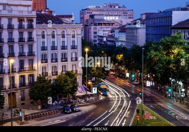 Spain Europe Spanish Hispanic Madrid Chamberi Plaza Alonzo Martinez dusk night nightlife traffic city skyline residential - Stock Image