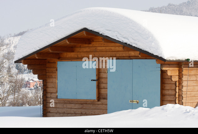 Garden pool house covered with a heavy fall of snow in Le Marche,Italy - Stock Image