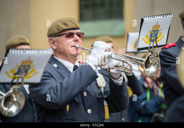 Male trumpet player in a military orchestra playing during National day celebrations in Norrkoping, Sweden. - Stock Image