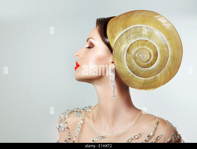 Extravagancy. Outlandish Extreme Hairstyle. Peculiar Woman with Snail as Headwear - Stock Image