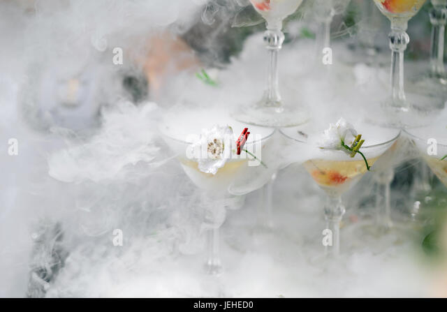 steaming pyramid of glasses for champagne - Stock Image