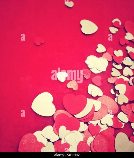Heart confetti on red felt background - Stock-Bilder