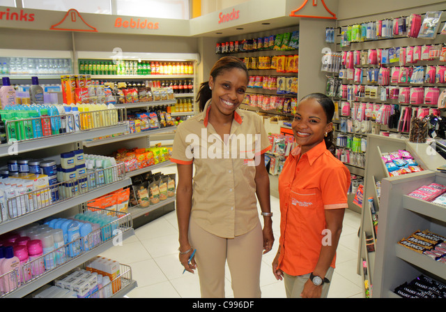 Curaçao Netherlands Antilles Dutch Curacao Hato International Airport concession shopping sundries Black woman - Stock Image
