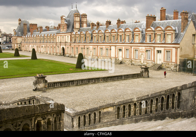 A lady walking at Fontainbleau Palace in Paris - Stock Image