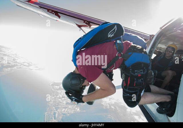 Skydivers bailing out of an airplane for a fun jump - Stock Image