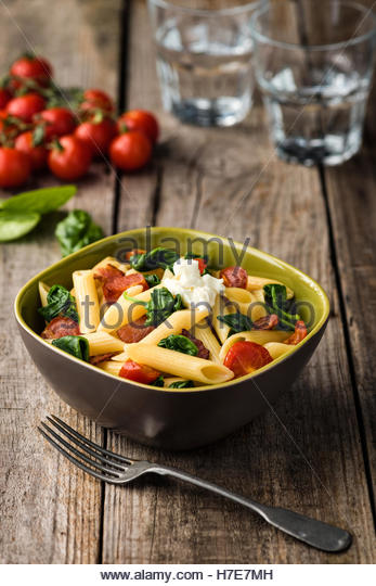 Tomato and Bacon Penne Pasta - Stock Image