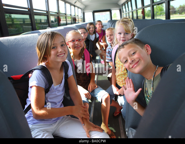 Group of school children on bus - Stock Image