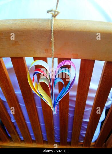 Paper love heart decoration at wedding - Stock Image