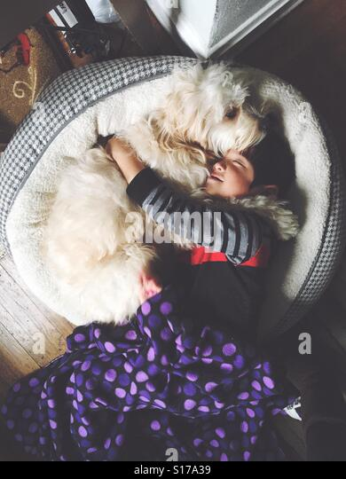 Boy and best friend snuggle. - Stock-Bilder