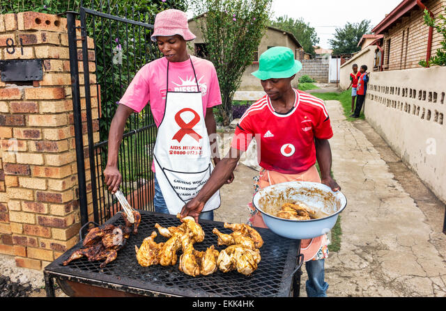 Johannesburg South Africa African Soweto Black man cooking barbecuing barbecue braai sale selling - Stock Image