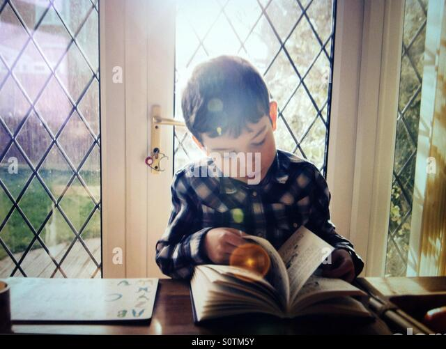 Boy reading - Stock Image