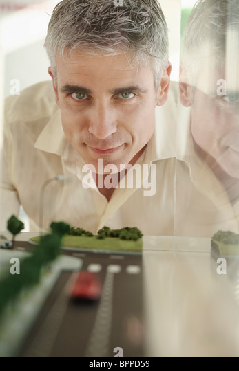 Older man with architectural model - Stock Image