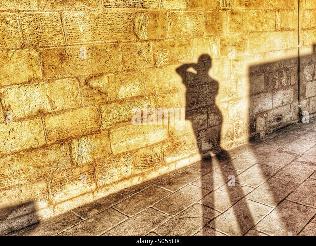 Shadow of photographer taking self portrait. - Stock Image