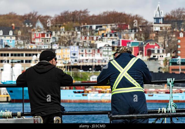 Longshoremen in harbour of St. John's, Avalon Peninsula, Newfoundland, Canada - Stock Image