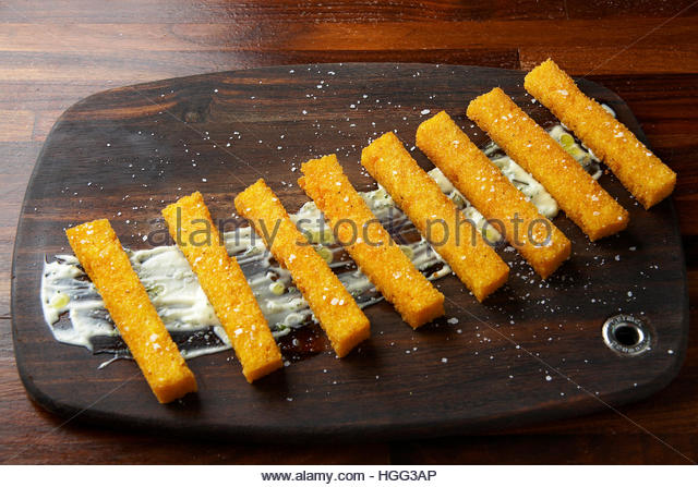 Fry polenta with garlic aioli - Stock Image